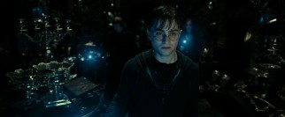 In darkness with wand lit, Harry Potter (Daniel Radcliffe) leads the search for Helga Hufflepuff's Cup.