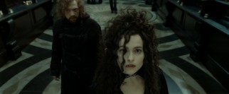 Hermione poses as wicked Bellatrix Lestrange (Helena Bonham Carter) while Ron dons a goatee as part of an effort to get in the vaults of Gringotts.