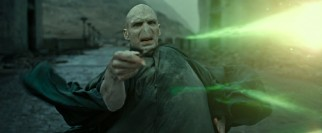 Avada Kedavra! Lord Voldemort (Ralph Fiennes) hits Harry with his best shot. Fire away!