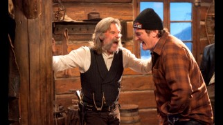 "A behind-the-scenes photo shows Kurt Russell and Quentin Tarantino sharing a laugh on set in ""Beyond the Eight."""