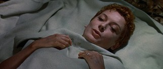 Recovering out of her habit, Sister Angela (Deborah Kerr) reveals a head of short red hair.