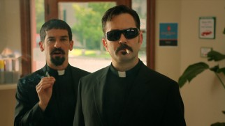 Writers/directors Robert Ben Garant and Thomas Lennon play the cigarette-smoking, sunglass-wearing priests from the Vatican.
