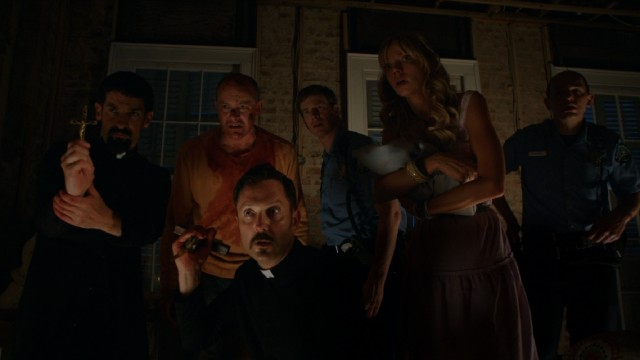 "Priests, police officers, and kin are on hand to watch the climactic birth of ""Hell Baby."""