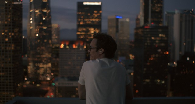 "With Samantha in his ear, Theodore Twombly (Joaquin Phoenix) takes in the sight of the future Los Angeles in ""Her."""