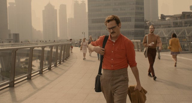 "With his mustache, bright shirt, and high-waisted pants, Theodore Twombly (Joaquin Phoenix) is a stylish man of the future in ""Her."""