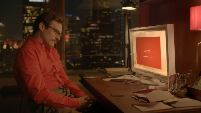 "Theodore Twombly (Joaquin Phoenix) prepares to meet his new operating system in Spike Jonze's ""Her."""