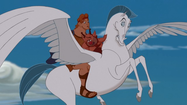 "Hercules and Phil take a ride on Pegasus the flying horse in Disney's 1997 animated feature ""Hercules."""