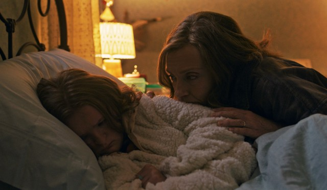 "Annie Graham (Toni Collette) consoles her troubled 13-year-old daughter Charlie (Milly Shapiro) in ""Hereditary."""
