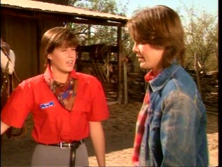 Brad (Kelly Brown) teaches teen heartthrob Bobby Rogers (Paul Whitthorne) how to ride horses.