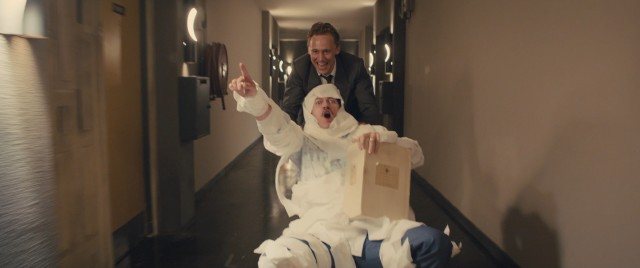 "Dr. Laing (Tom Hiddleston) wheels a toilet paper-wrapped Richard Wheeler (Luke Evans) down the hall in the free-spirited times before things get mad in ""High-Rise."""