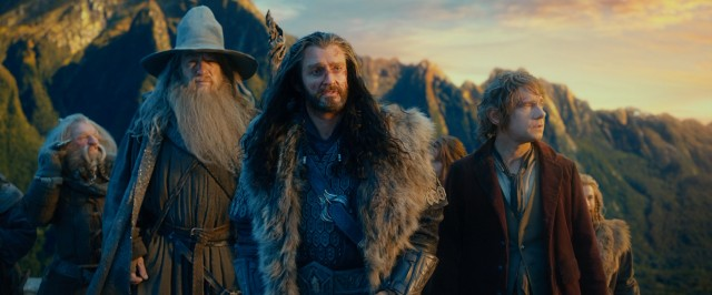 Gandalf (Ian McKellen), a bruised Thorin (Richard Armitage), and Bilbo (Martin Freeman) look ahead to two long sequels.
