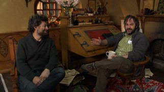 "Sitting at Bilbo Baggins' desk, Peter Jackson and his Gollum/second unit director Andy Serkis discuss ""New Zealand: Home of Middle-Earth."""