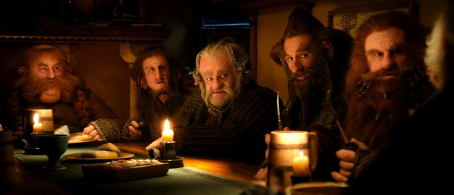 Hungry, hairy dwarves gather around Bilbo Baggins' table for an unexpected feast.