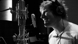 "Ed Sheeran gets into his end credits song ""I See Fire"" in his black and white portions of its music video."