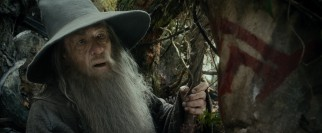 Gandalf (Ian McKellen) recognizes a symbol that gives him pause while out journeying with the dwarves and Bilbo.