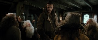 The widower Bard (Luke Evans) towers above his guests as a man among dwarves.