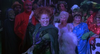 Winifred Sanderson (Bette Midler) fits right in at the costumed adult dance at Salem's Town Hall.
