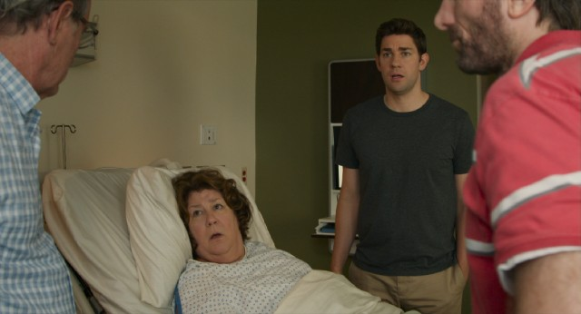 "In ""The Hollars"", a mother's (Margo Martindale) brain tumor reunites her family (John Krasinski, Richard Jenkins, and Sharlto Copley) at the hospital."