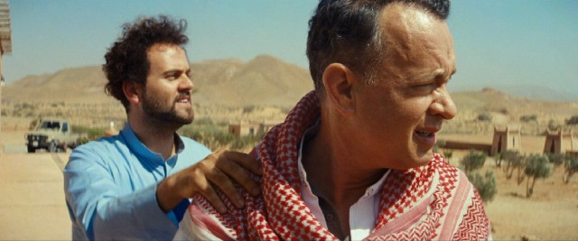 Alan (Tom Hanks) tags along with Yousef (Alexander Black) on his trip to the country.