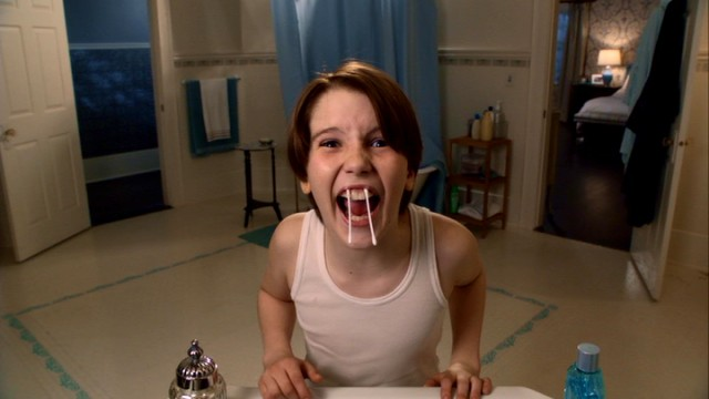 "When parents are away, children will play in front of a bathroom mirror. Finn Baxter (Christian Martyn) shows he can handle aftershave better than Kevin McCallister, and also make use of Q-tip fangs in ""Home Alone: The Holiday Heist."""