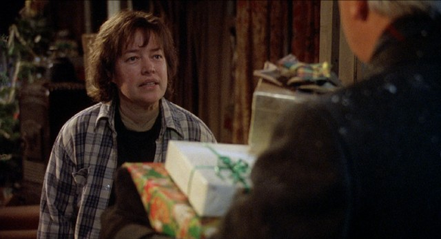 Even on Christmas Eve, Frances Lacey (Kathy Bates) holds steadfast to her resistance to charity, turning away a present-bearing Catholic priest who drops by.