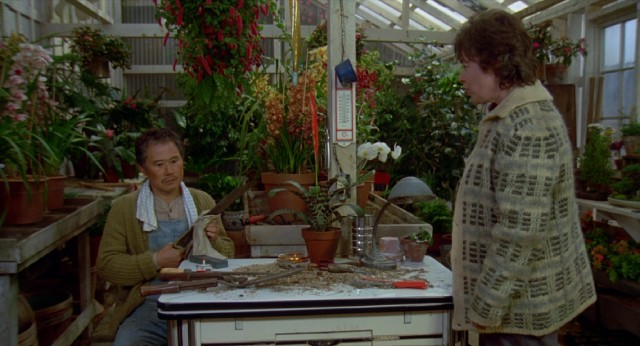 Frances Lacey (Kathy Bates) talks widowed nursery owner Mr. Munimura (Soon-Tek Oh) into giving her land in exchange for her family's labor.