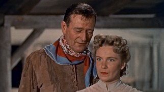 Hondo Lane (John Wayne) demonstrates his impeccable sense of smell by noting all the scents he picks up on Angie (Geraldine Page).