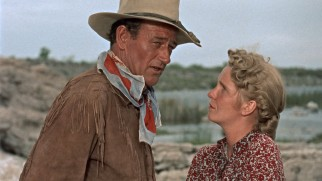 Angie (Geraldine Page) may be a homely woman, but Hondo (John Wayne) might love her all the same.