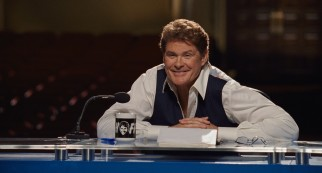 "David Hasselhoff plays himself, the host of a reality TV series called ""Hoff Knows Talent."""