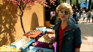 "Cody Simpson samples the sweets at a ""Hop"" promotional event."