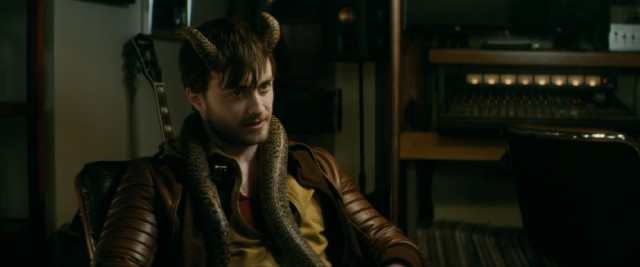 "A snake slithers around the neck of Ig Perrish (Daniel Radcliffe) in ""Horns."""