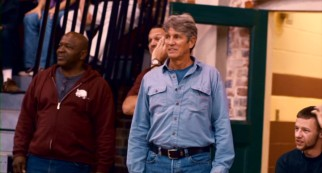 Postmaster Laurence Humphrey (Eric Roberts) shows up late, but likes what he sees in his wife's decisive basketball game.