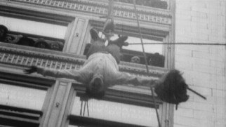 The real Harry Houdini defies death, dangling high above San Francisco upside-down in this old clip.