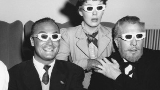 "Director Andre de Toth and stars Phyllis Kirk and Vincent Price don their 3D glasses and brace themselves in this vintage publicity photo featured in ""'House of Wax': Unlike Anything You've Seen Before."""