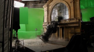Green screen, a facade, and a scale train are used to create an exciting nightmare sequence.