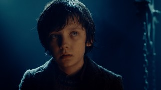 "Hugo Cabret (Asa Butterfield), the eponymous protagonist of ""Hugo"" is a twelve-year-old orphan who lives inside a large Paris train station clock that he maintains."