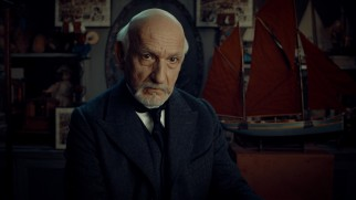 Georges Méliès (Ben Kingsley) confiscates Hugo's notebook and requires him to work in his toy shop to get it back.