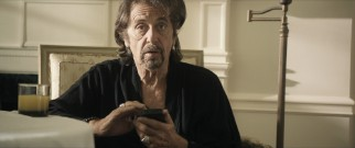 Simon Axler (Al Pacino) struggles to describe his relationship, while playing with his smart phone.