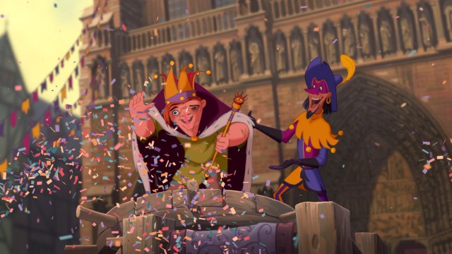 Alongside Clopin, Topsy Turvy Day's King of Fools waves to his adoring public.