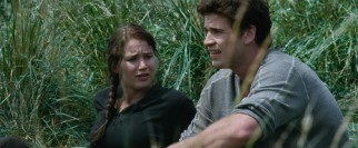 In volunteering for the Hunger Games, Katniss (Jennifer Lawrence) leaves her hunky friend Gayle (Liam Hemsworth) back home.