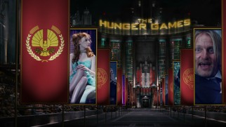 Disc 1's ornate menu scene has Foxface looking over at a goofy Haymitch in City Circle banners displaying narrow clips.