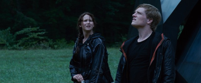 District 12 tributes Katniss Everdeen (Jennifer Lawrence) and Peeta Mellark (Josh Hutcherson) stick together in the 74th Hunger Games.