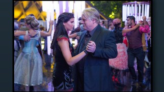 "Katniss' dance with Plutarch (Philip Seymour Hoffman) is one of many Murray Close still photographs from the series displayed in ""Picturing Panem."""