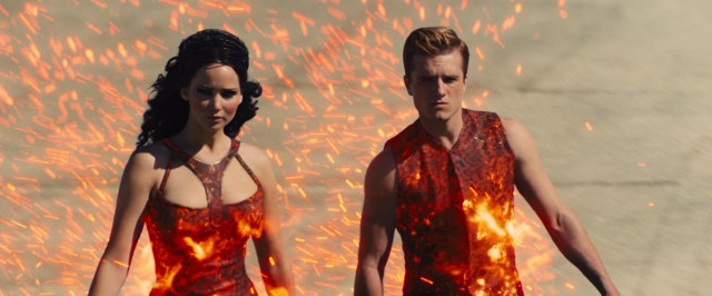 Katniss Everdeen (Jennifer Lawrence) and Peeta Mallark (Josh Hutcherson) are catching fire at the opening ceremony of the 75th (Third Quarter Quell) Hunger Games.