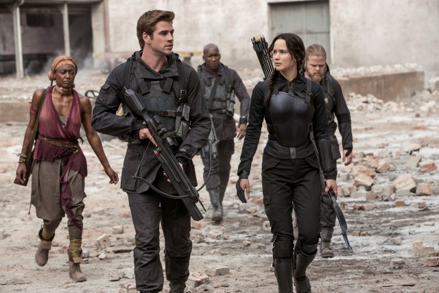 "Gale (Liam Hemsworth) and Katniss (Jennifer Lawrence) visit the ravaged District 8 in ""The Hunger Games: Mockingjay, Part 1."""