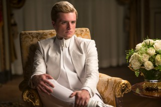 Separated from Katniss, Peeta Mellark (Josh Hutcherson) appears in a televised interview by Caesar Flickerman.