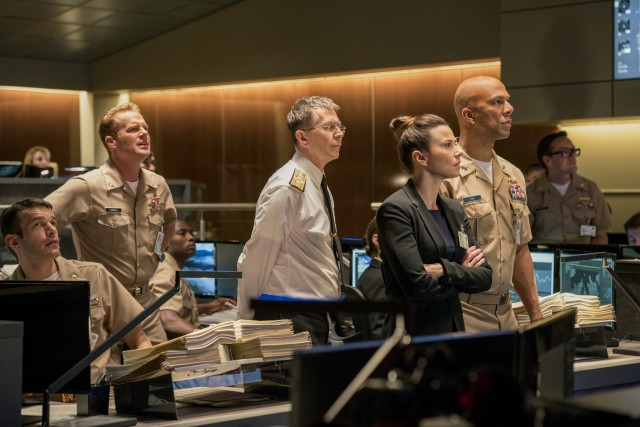 Gary Oldman, Linda Cardellini, and Common put on their best concerned faces as the government figures observing the USS Arkansas' actions from afar.