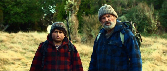 "In ""Hunt for the Wilderpeople"", foster child Ricky Baker (Julian Dennison) and his outdoorsy foster father Hec Faulkner (Sam Neill) go missing in the wild."