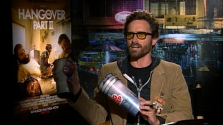 Miles Davis-Davidson (Rob Benedict) tries to get the true story of what happened in Bangkok, by questioning Justin Bartha on Big Gulp cups in the unauthorized documentary mockumentary.