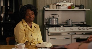 After some reluctance and thought, Aibileen (Viola Davis) decides to open up to Skeeter and lend her decades of experience to a book.